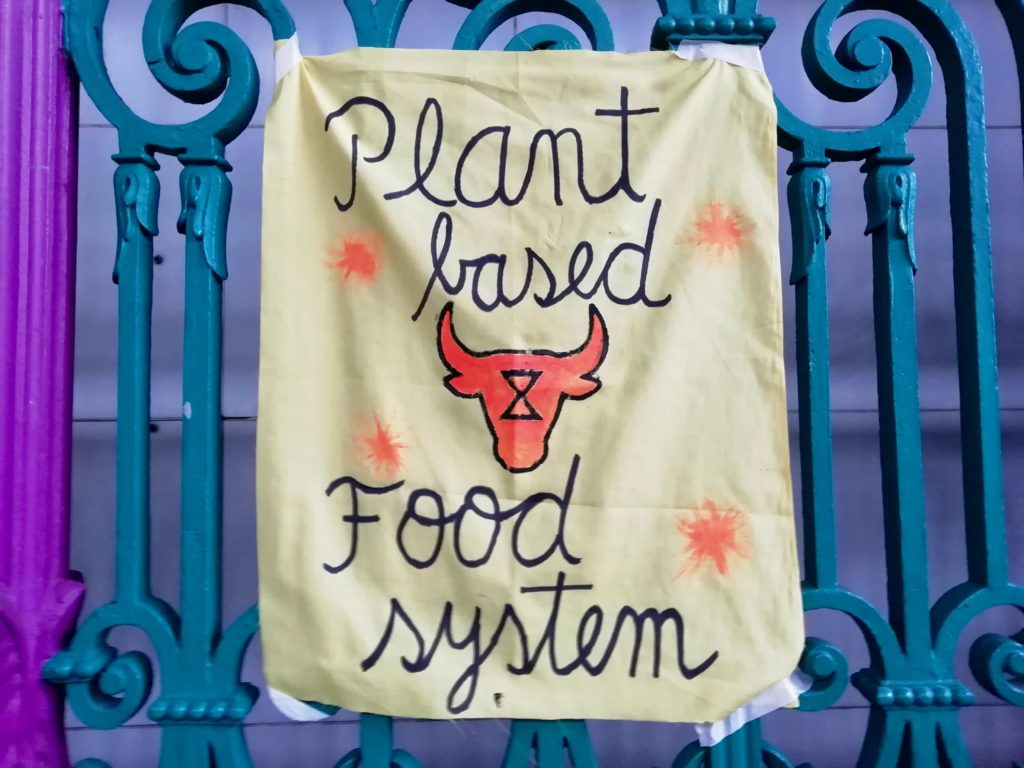 Plant Based Food System banner at Smithfield's Animal Rebellion occupation