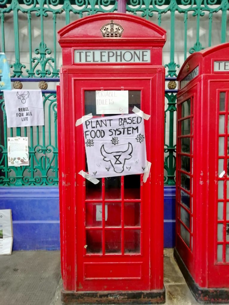London telephone box with Plant Based Food System banner on